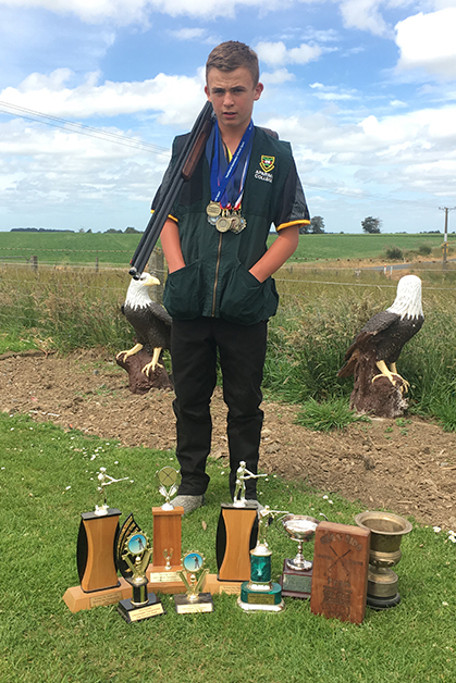 Rhys with his trophies and medals.